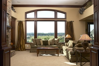 A living room with countryside view outside the window