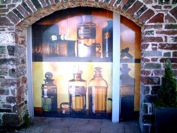 a fireplace with a wall graphic of bottles