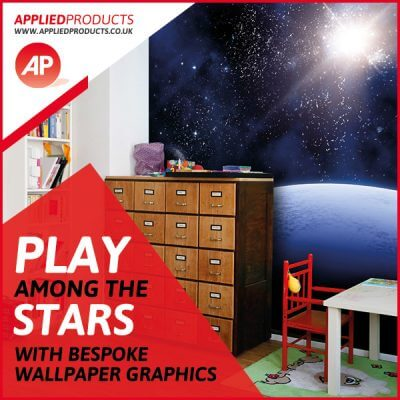 A child's nursery with space graphics on the wall