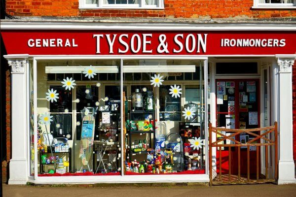 A shop front covered in daisy window graphics