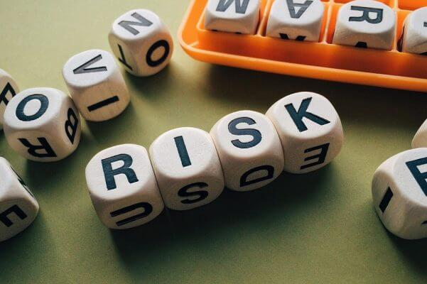 Dice spelling out risk