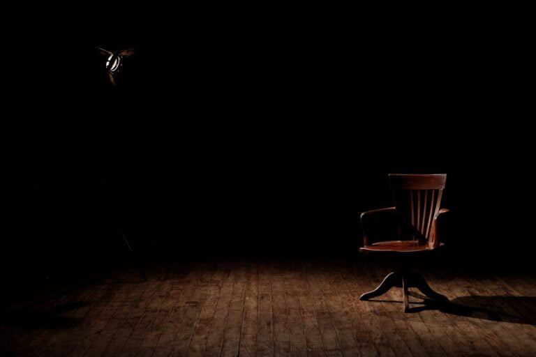 A chair in a dark room