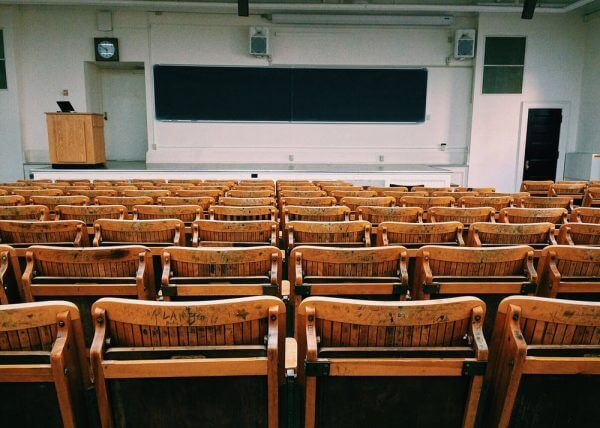 A classroom filled with chairs facing a board