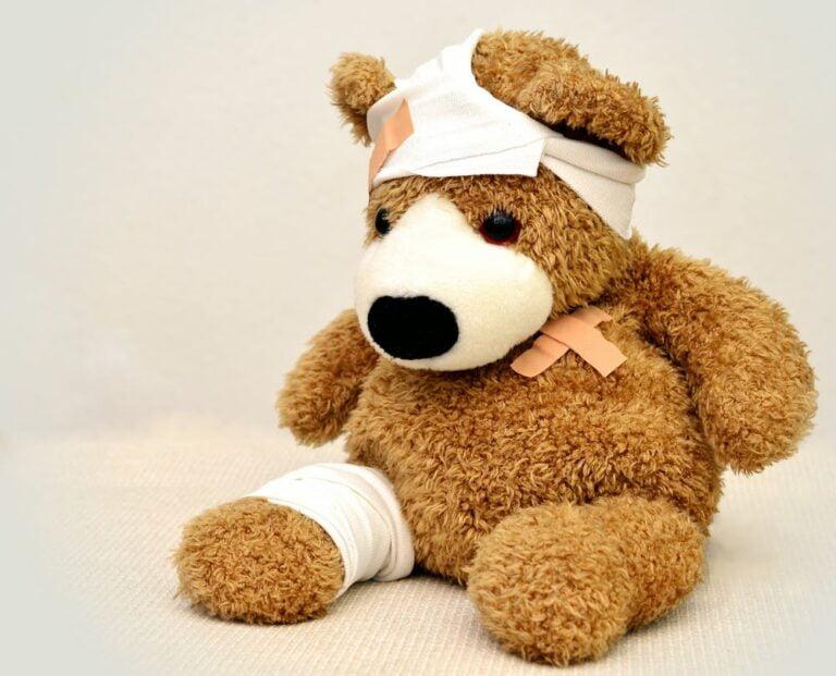 teddy bear with a bandage