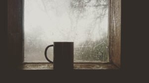 a mug in front of a window with winter outside