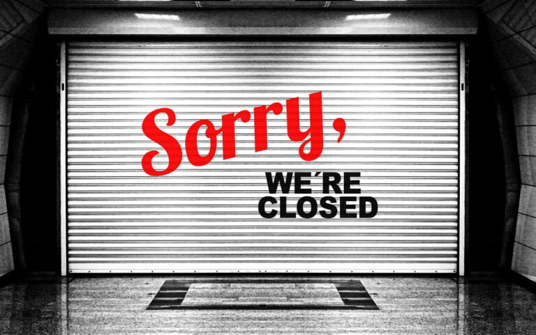 sorry we're closed written on a garage door
