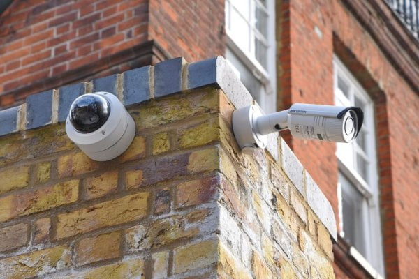 two security cameras on the exterior of a building