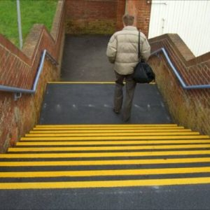 anti-slip tape on the edges of steps to represent products for preventing workplace accidents